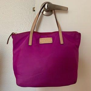 Kate Spade shoulder bag with dot pattern.